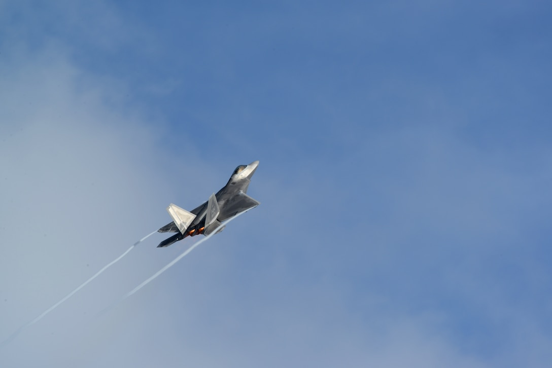 An F-22 Raptor climbs after take-off from the flightline Nov. 24, 2014 at Andersen Air Force Base, Guam. A C-17 Globemaster III along with several F-22s operated from Andersen to practice flexibility in aircraft movement at a non-traditional base with additional pilots, maintenance support and accompanying fuel and munitions. (U.S. Air Force photo by Airman 1st Class Amanda Morris/Released)