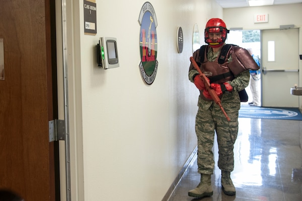Staff Sgt. Scott Mellott, 902nd Security Forces Squadron NCO in charge of plans, plays the role of an active shooter during a Counter Active Shooter Tactics class Nov. 4 at Joint Base San Antonio-Randolph.(U.S. Air Force photo by Airman 1st Class Stormy Archer)