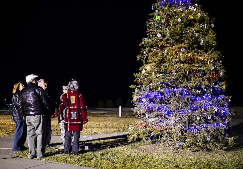 Family members of the late Senior Airman Kristopher Mansfield light the tree in honor of Kristopher Dec. 2, 2014, on Buckley Air Force Base, Colo. The tree-lighting ceremony honored Kristopher and Senior Airman Michael Snyder, both members of the 460th Space Communications Squadron who were killed by drunk drivers. (U.S. Air Force photo by Senior Airman Riley Johnson/Released)