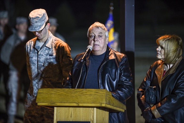Craig Mansfield, father of the late Senior Airman Kristopher Mansfield, speaks about his son during a tree-lighting ceremony Dec. 2, 2014, on Buckley Air Force Base, Colo. The ceremony honored Kristopher and Senior Airman Michael Snyder, both members of the 460th Space Communications Squadron who were killed by drunk drivers. (U.S. Air Force photo by Senior Airman Riley Johnson/Released)