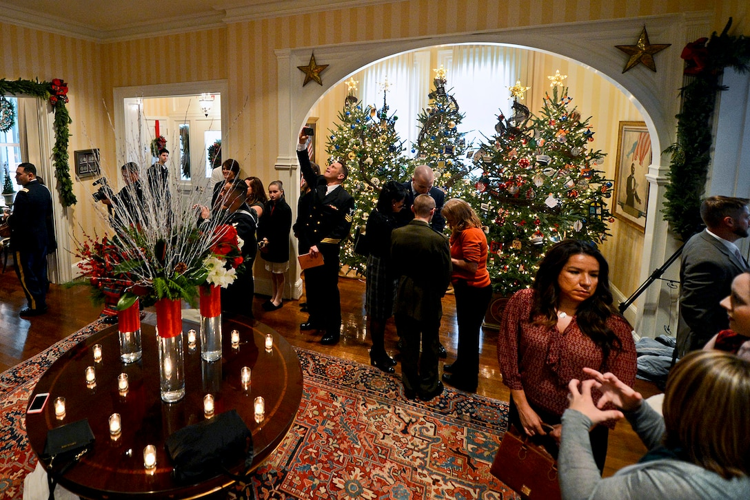 Military service members and their families attend a holiday reception at the residence of Vice President Joe Biden and his wife, Dr. Jill Biden, in Washington, D.C., Dec. 3, 2014. Dr. Biden (not pictured) hosted the event to honor service members, veterans and their families. Guests included military families whose ornaments have decorated several holiday trees at the vice president's residence. Senior military spouses, and guests from the Naval Observatory, Camp David and Full Circle Home also attended the event.