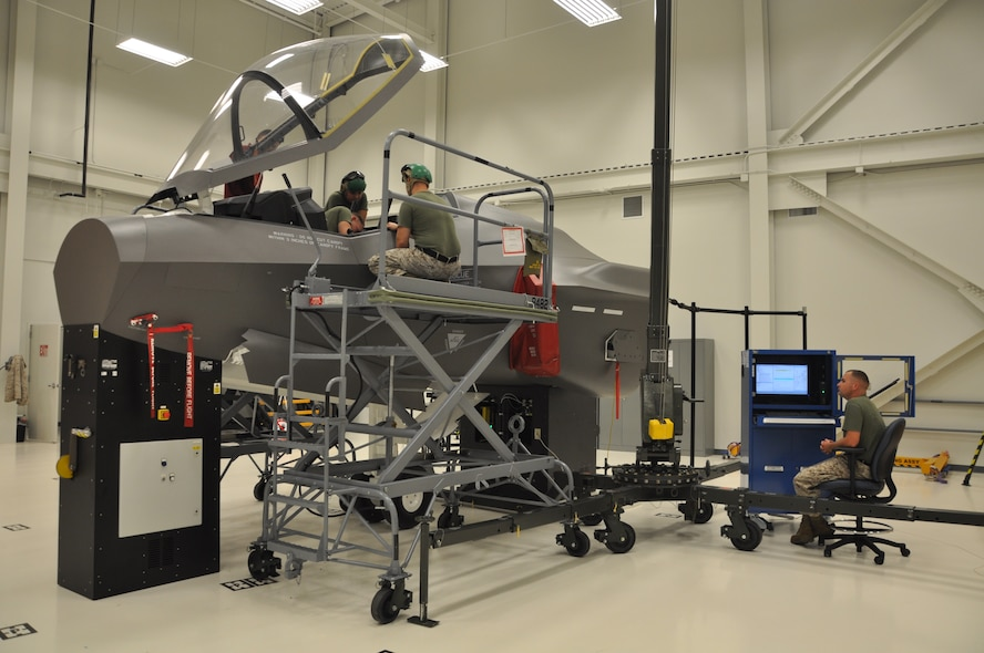 U.S. Marine Corps F-35 Lightning II maintainer students train at the ejection seat maintenance trainer at the 33rd Fighter Wing's F-35 Academic Training Center on Eglin Air Force Base, Fla., Sept. 9, 2012. The pilot and maintainer qualifications are accomplished through simulations to ensure efficient mission readiness. As the first of its kind in the Department of Defense, the wing is responsible for F-35 Lightning II pilot and maintainer training for the DOD and, in the future, at least eight coalition partners. (U.S. Air Force courtesy photo)