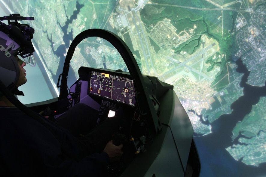 An Airman practices on an F-35 Lightning II full mission simulator at the 33rd Fighter Wing's F-35 Academic Training Center on Eglin Air Force Base, Fla., Nov. 22, 2013. The pilot and maintainer qualifications are accomplished through simulations to ensure efficient mission readiness. As the first of its kind in the Department of Defense, the wing is responsible for F-35 Lightning II pilot and maintainer training for the DOD and, in the future, at least eight coalition partners. (U.S. Air Force courtesy photo)