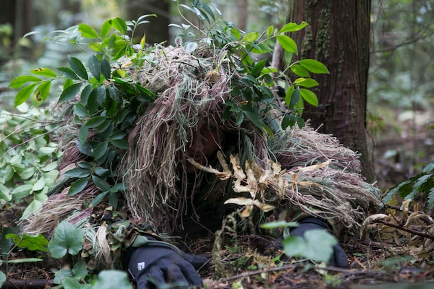 A Japan Ground Self-Defense Force member low crawls toward an objective Dec. 2 in the Oyanohara Training Area in Yamato, Kumamoto prefecture, Japan. The stalk lane training was part of Forest Light 15-1, a semi-annual, bilateral exercise consisting of a command post exercise and field training events conducted by elements of III Marine Expeditionary Force and the JGSDF to enhance the U.S. and Japan military partnership, solidify regional security agreements and improve individual and unit-level skills. The JGSDF member is a scout sniper with 42nd Regiment, 8th Division, Western Army, JGSDF.