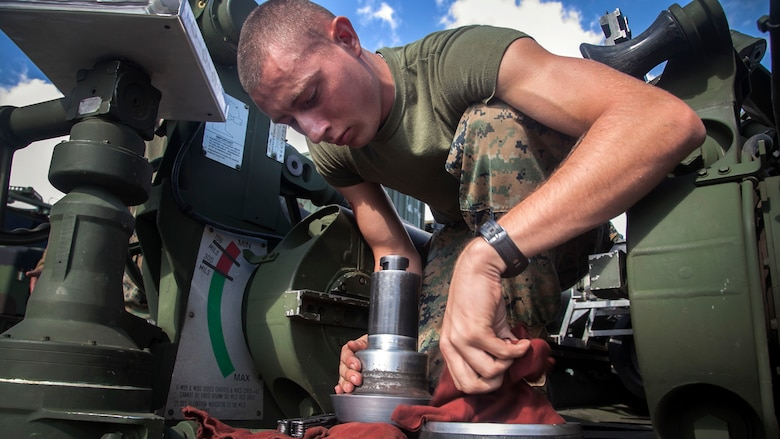 Lance Cpl. Johnathan Dowden, from Wichita Falls, cleans a spindle from an M777A2 lightweight 155 mm howitzer during a command post exercise Oct. 30 for Artillery Training Relocation Program 14-3 at Camp Fuji. The exercise focused on communications between the fire direction center and teams manning the howitzers. ARTP prepared artillery batteries for a smooth execution of training in the North Fuji Maneuver Area by affording teams a chance to troubleshoot any problems with their weapons before moving to the live-fire training. Dowden is an artilleryman with Battery I, 3rd Battalion, 11th Marine Regiment, based out of Twentynine Palms, Calif., and is currently assigned to 3rd Bn., 12th Marine Regiment, 3rd Marine Division, III Marine Expeditionary Force, under the unit deployment program.