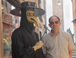 Dr. Igor Linkov, right, with a model in a 14th century plague mask suit, one of the black plague protective measures used by Venetian doctors to try to reduce transmission during the massive epidemic.
