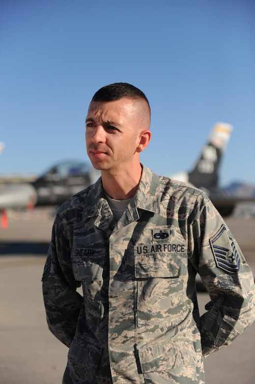 Master Sgt. Shane Sneary answers questions during an interview with the 2nd Combat Camera Squadron Oct. 31, 2014, on the flightline at Nellis Air Force Base, Nev. Sneary was interviewed about his cost saving submission to the Airmen Powered by Innovation program. Sneary is a repair enhancement program manager with the 57th Maintenance Group. (U.S. Air Force photo/Airman 1st Class Mikaley Towle)