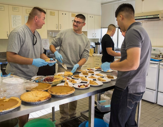 Marines and sailors cut pieces of pie for a Thanksgiving celebration Nov. 23 with residents and staff of the Tai Chu En Children's Home at the Camp Kinser Chapel. The event brought together over 50 volunteers including Marines, sailors and spouses. The event included making festive paper hats and an American Thanksgiving meal. The Marines and sailors are with Combat Logistics Regiment 35, 3rd Marine Logistics Group, III Marine Expeditionary Force.