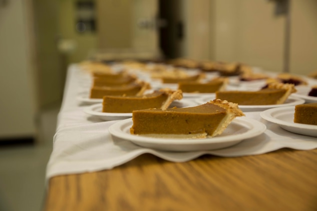 Pumpkin pie is staged Nov. 23 prior to a Thanksgiving feast set up by volunteers with Combat Logistics Regiment 35 for the second annual Thanksgiving celebration with the residents and staff of the Tai Chu En Children's Home at the Camp Kinser Chapel. In America, it is a common tradition to have pumpkin pie for dessert after Thanksgiving dinner. For most of the children, it was there first time tasting pumpkin pie and also turkey.