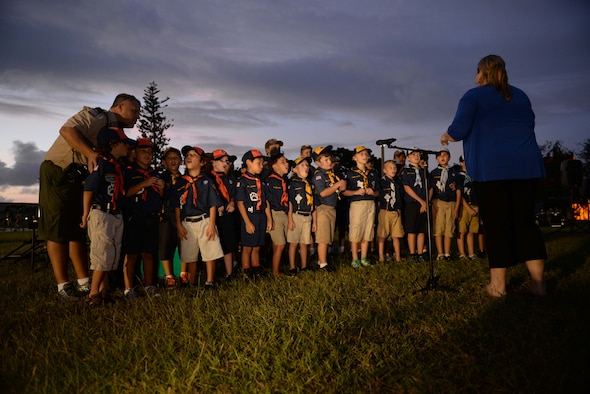 Cub Scout Pack 20 sing holiday songs at the base tree lighting ceremony Dec. 2, 2014, at Andersen Air Force Base, Guam.  Andersen held the annual ceremony to bring families together during the holiday season. (U.S. Air Force photo by Airman 1st Class Amanda Morris/Released.)