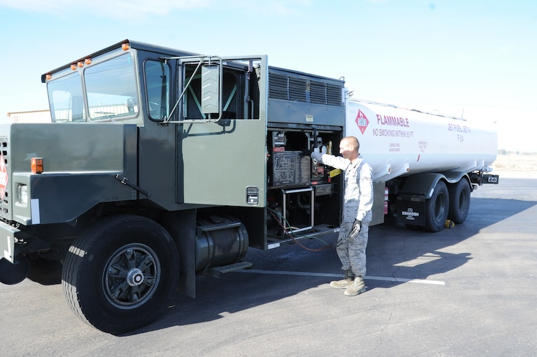 Senior Airman Jacob Hartman, 56th Logistic Readiness Squadron fuels distribution operator, checks out the newly painted R-11 refueling truck at the LRS vehicle yard. After receiving waiver approval from the Air Education and Training Command, the 56th LRS had the truck painted white to keep the fuel inside from overheating. The F-35 Lightning II joint strike fighter has a fuel temperature threshold and cannot function properly if the fuel temperature is too high. (U.S. Air Force photo/Staff Sgt. Luther Mitchell Jr.)
