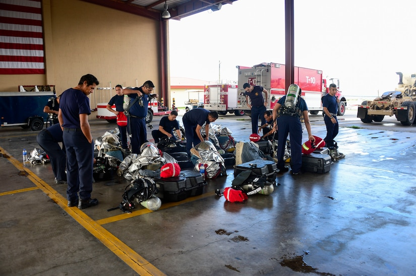 Firefighters from El Salvador check their personal protective equipment and self-contained breathing apparatus during an orientation given by the 612th Air Base Squadron firefighters  on Soto Cano Air Base, Honduras, Dec. 3, 2014.  The 612th ABS firefighters facilitated El Salvador's Autonomous Executive Port Commission airport firefighter qualification by providing live-fires.  The Salvadoran airport firefighters have a requirement very similar to the United States standards that requires members of their airport fire departments to be qualified annually on their ability to control a live-fire.   (U.S. Air Force photo/Tech. Sgt. Heather Redman)