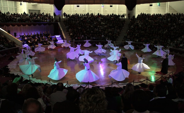 Whirling Dervishes perform in Konya, Turkey. Since the 13th century, Konya's citizens have welcomed foreign tourists. Annual performances are given during the week preceding Dec. 17. (Courtesy photo by Fatma Yoksuloglu)
