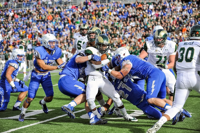 The U.S. Air Force Academy Falcons take down the Colorado State University Rams Nov. 28, 2014, in Colorado Springs, Colo. Air Force beat CSU 27-24. The Rams, ranked No. 21 before their loss at Falcon field and were heavily favored to win. Air Force's strong game and a last second, 39-yard field goal by Falcons' kicker/punter Will Conant, gave the Falcons their sixth home win of the season. (U.S. Air Force photo/Liz Copan)