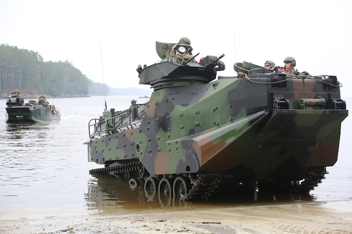 Marines with the Amphibious Assault Vehicle Platoon, Company B, Ground Combat Element Integrated Task Force, come ashore at the French Creek loading dock at Marine Corps Base Camp Lejeune, North Carolina, Dec. 2, 2014, to transport Company A Marines to the Verona Loop training area on Camp Lejeune to conduct a three-day live-fire training event with the M27 Infantry Automatic Rifle. (U.S. Marine Corps photo by Sgt. Alicia R. Leaders/Released)