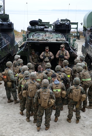 Marines with 2nd Platoon, Company A, Ground Combat Element Integrated Task Force, receive their safety brief prior to boarding amphibious assault vehicles at Marine Corps Base Camp Lejeune, North Carolina, Dec. 2, 2014. Marines with AAV Platoon, Company B, GCEITF, transported Co. A Marines to the Verona Loop training area on Camp Lejeune to conduct a three-day M27 Infantry Automatic Rifle live-fire event. (U.S. Marine Corps photo by Sgt. Alicia R. Leaders/Released)