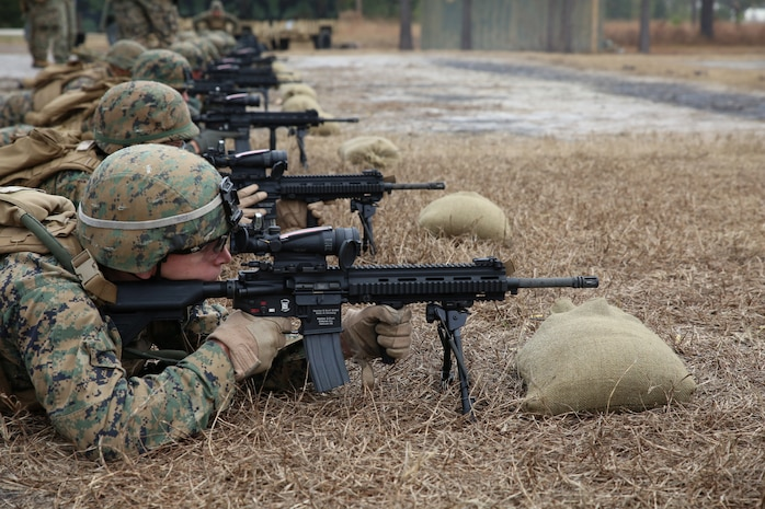 Lance Cpl. Anthony A. Ayr, rifleman with 2nd Platoon, Company A, Ground Combat Element Integrated Task Force, confirms his 100-meter zero with the M27 Infantry Automatic Rifle during a three-day field exercise at the Verona Loop training area on Marine Corps Base Camp Lejeune, North Carolina, Dec. 3, 2014. (U.S. Marine Corps photo by Sgt. Alicia R. Leaders/Released)