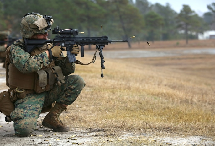 Sgt. Luis E. Martinez, rifleman with 1st Platoon, Company A, Ground Combat Element Integrated Task Force, engages known-distance targets with the M27 Infantry Automatic Rifle from the kneeling position during a three-day field exercise at the Verona Loop training area on Marine Corps Base Camp Lejeune, North Carolina, Dec. 3, 2014. (U.S. Marine Corps photo by Sgt. Alicia R. Leaders/Released)