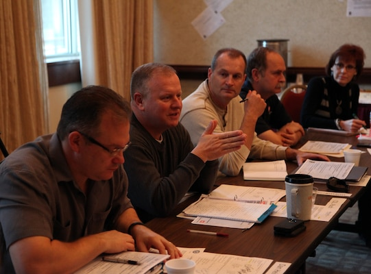 Huntsville Center Business Director Dan Heinzelman, Commander Col. Robert Ruch, Deputy Commander Lt. Col. Kendal Bergmann, Programs Director Charles Ford and Tracy Edmonds, a project manager with the  Center's Army Central Metering program, participate in a strategic off site Dec. 3 at Lake Guntersville State Park Lodge in Guntersville, Alabama. The meeting allowed Center senior and emerging leaders to look over recent guidance from Headquarters U.S. Army Corps of Engineers and determine the direction of Huntsville Center within the paradigms set by the new USACE Campaign Plan.