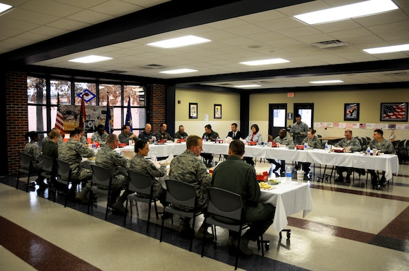 A group of Airmen from the 188th Wing join Lt. Gen. Stanley E. Clarke III, director of the Air National Guard, for lunch at Ebbing Air National Guard Base, Fort Smith, Ark. Dec. 5, 2014. Clarke engaged with Airmen of all levels and learned of their outstanding contributions to the mission at the 188th Wing. (U.S. Air National Guard photo by Airman 1st Class Cody Martin/released)