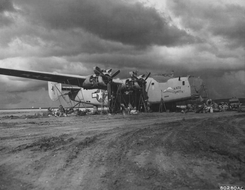 "The 43rd Service Group found itself a long way from Portland, Oregon as World War II transpired.  Here a Consolidated B-24D-85-CO Liberator heavy bomber, serial number 42-40654, ""KATE SMITH"" of the 345th Bombardment Squadron, 98th Bomb Group, is overhauled by men of the 43rd Service Group at an airfield near Benghazi, Cyrenaica, Libya, circa the summer of 1943.  (USAAF Photo)"