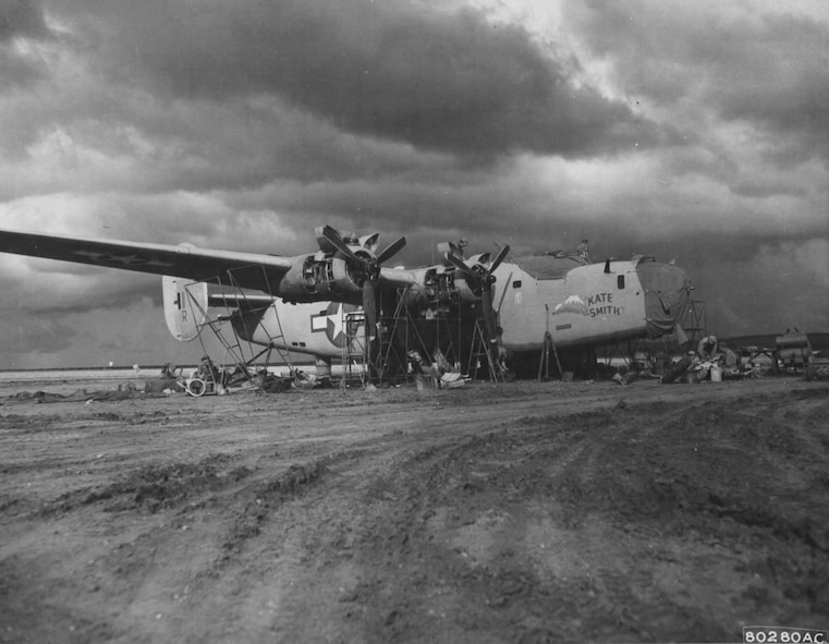 """The 43rd Service Group found itself a long way from Portland, Oregon as World War II transpired.  Here a Consolidated B-24D-85-CO Liberator heavy bomber, serial number 42-40654, """"KATE SMITH"""" of the 345th Bombardment Squadron, 98th Bomb Group, is overhauled by men of the 43rd Service Group at an airfield near Benghazi, Cyrenaica, Libya, circa the summer of 1943.  (USAAF Photo)"""