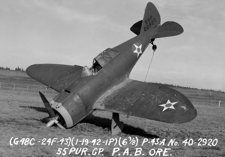"Republic P-43A Lancer nose-over in the sod at Portland AAB, 19 January 1942.  Note the visual characteristics of the P-43 which would be carried forth into the Republic P-47 Thunderbolt design, as seen in the shape of the wings and the ""razorback"" style canopy and angled shape of the windscreen.  The ""55P"" on the tail indicates assignment to the 55th Pursuit Group, and the aircraft serial number is carried immediately below.  The number ""92"" suggests assignment to a high numbered squadron in the group, perhaps the 54th Pursuit Squadron.  (Courtesy Mr. Jack Cook)"