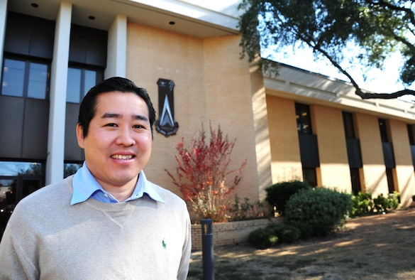 Nori Katagiri, Air War College international security studies assistant professor, stands in front of The Air University's AWC at Maxwell Air Force Base, Alabama, Nov. 14, 2014. Katagiri was born in Japan before traveling to the U.S. on a student visa and earning his Ph. D. from the University of Pennsylvania. (U.S. Air Force photo by Airman 1st Class Alexa Culbert/Cleared)