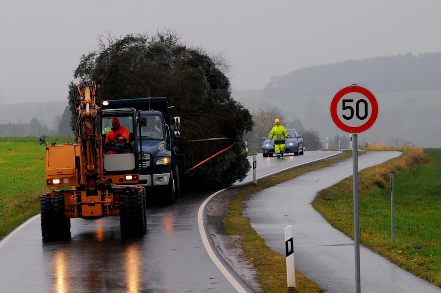 A truck assigned to the 52nd Civil Engineer Squadron drags an evergreen tree from Spangdahlem, Germany, Nov. 26, 2014. The city's community donated the tree to Spangdahlem Air Base to support the tree-lighting ceremony. (U.S. Air Force photo by courtesy photo/Released)