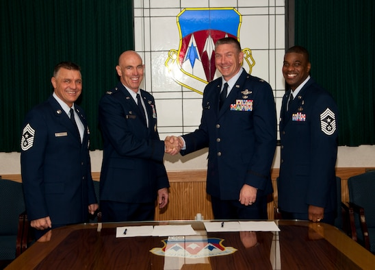 VANCE AIR FORCE BASE, Okla. -- (Left to Right) Chief Master Sgt. Peter Speen, the 71st Flying Training Wing command chief; Col. Clark Quinn, the 71st FTW commander; Col. William Spangenthal, 97th Air Mobility Wing commander; and Chief Master Sgt. James Powell, 97th AMW command chief, sign a Memorandum of Understanding Nov. 21 that will allow Team Vance to host two Airman Leadership School classes per year. ALS is the first level of professional military education that senior airmen attend upon being selected for staff sergeant. (U.S. Air Force photo/Staff Sgt. James Bolinger)