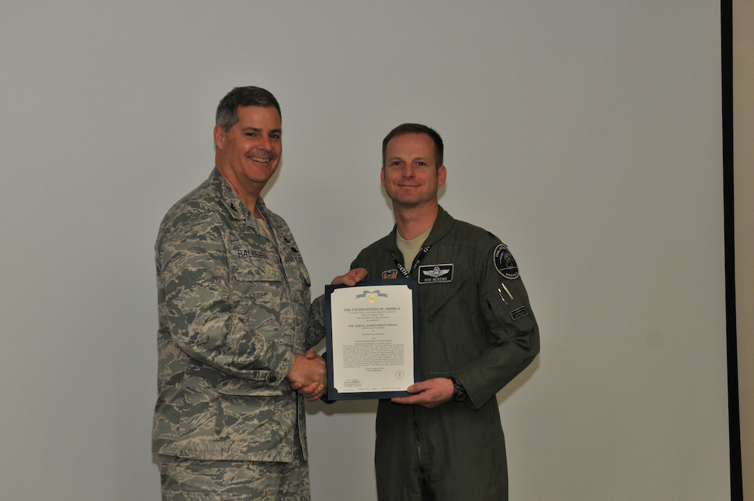 Lt. Col. Ronald Berzins is being awarded the Aerial Achievement Medal on Dec 6, 2014, at the 174th Attack Wing  in Syracuse, NY. (New York Air National Guard Tech. Sgt. Justin A. Huett)