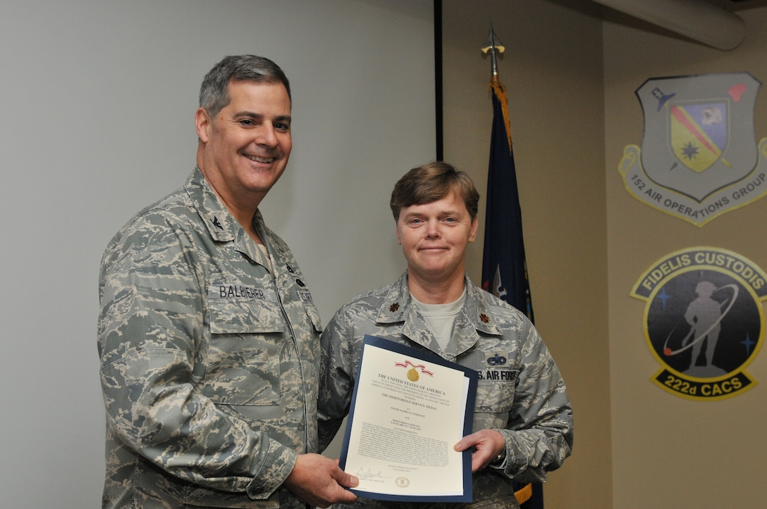 Major Sandra Stoquert of the 174th Attack Wing in Syracuse, N.Y. was awarded the Meritorious Service Medal on Dec 6, 2014 for outstanding service while assigned to the 174th Maintenance Group. (New York Air National Guard photo by Tech. Sgt. Justin A. Huett)