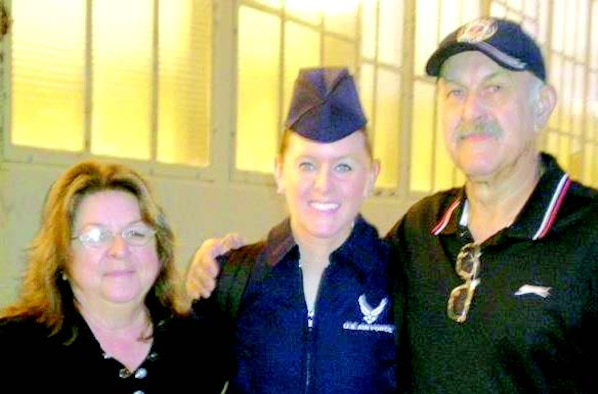 Kristie Volchko flanked by her mom, Carole (L), and her dad, Ronald, following her graduation from training in Wichita Falls, TX.