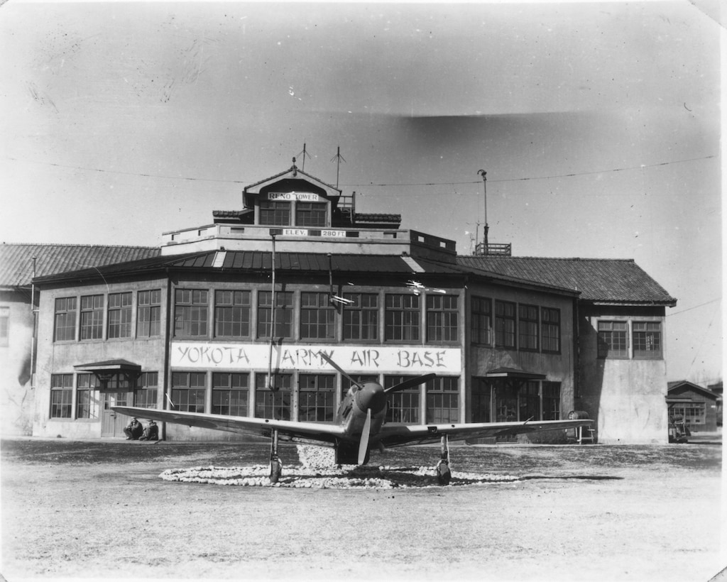 This photo, taken in March of 1946 shows the old operations building, as well as a Japanese fighter that was on static display at Yokota Air Base for many years. (U.S. Air Force photo courtesy of the 374 Airlift Wing History Office)