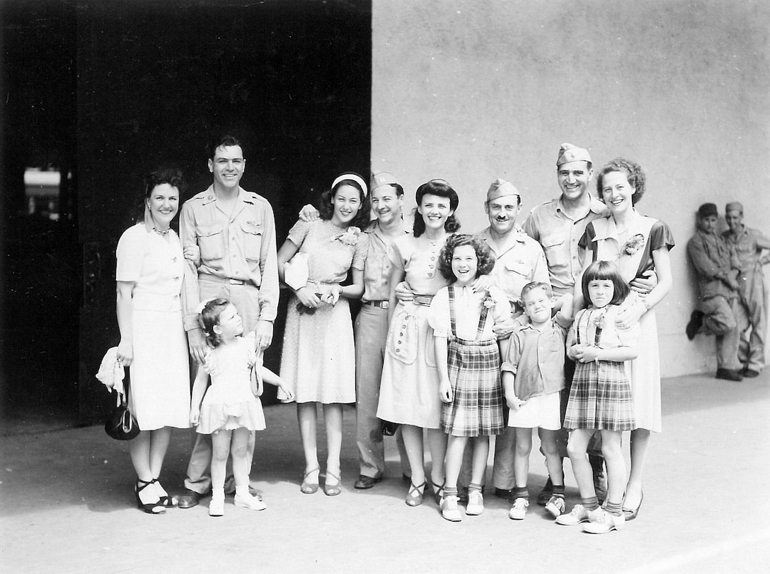 A photo of incoming dependents and Yokota Airmen taken at the Yokohama dock in August 1946. Base commander Col. Edwin Bobzien is third from the right, and Mrs. Bobzien is standing next to him. (U.S. Air Force photo courtesy of the 374 AW History Office)