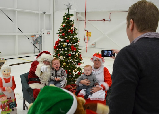 U.S. Airmen with the 128th Air Refueling Wing and their families participated in the wing holiday part here Dec. 6 2014.  Holiday party activities included visiting with Santa, children's crafts, a silent aution, and a wing trivia contest.  (U.S. Air National Guard photo by Master Sgt. Thomas J. Sobczyk/Released)