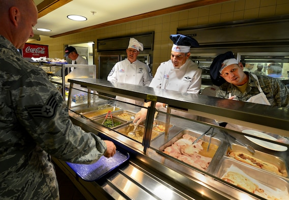 Chief Master Sgt. Tom Mason, the 919th Special Operations Wing command chief, Col.s James Phillips, 919th SOW commander and Kurt Matthews, 919th Special Operations Group commander, serve up the holiday meal at the Duke Field dining facility Dec. 6.  Members of the wing's leadership took turns serving up the lunch meal to the Airmen during the unit training assembly.  (U.S. Air Force photo/Tech. Sgt. Cheryl Foster)