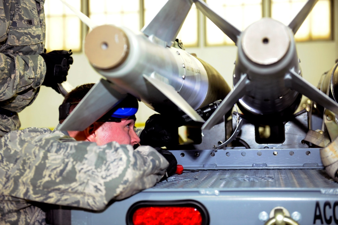 141206-Z-EZ686-007 –Senior Airman Welsey Retka of the 127th Maintenance Group prepares to load a simulated bomb during a Loadeo contest at Selfridge Air National Guard Base Mich., Dec. 6, 2014.  The Loadeo contest is an annual contest with three competing teams that are scored for their ability to load missiles accurately and in a timely manner. (U.S. Air National Guard photo by MSgt. David Kujawa/Released)
