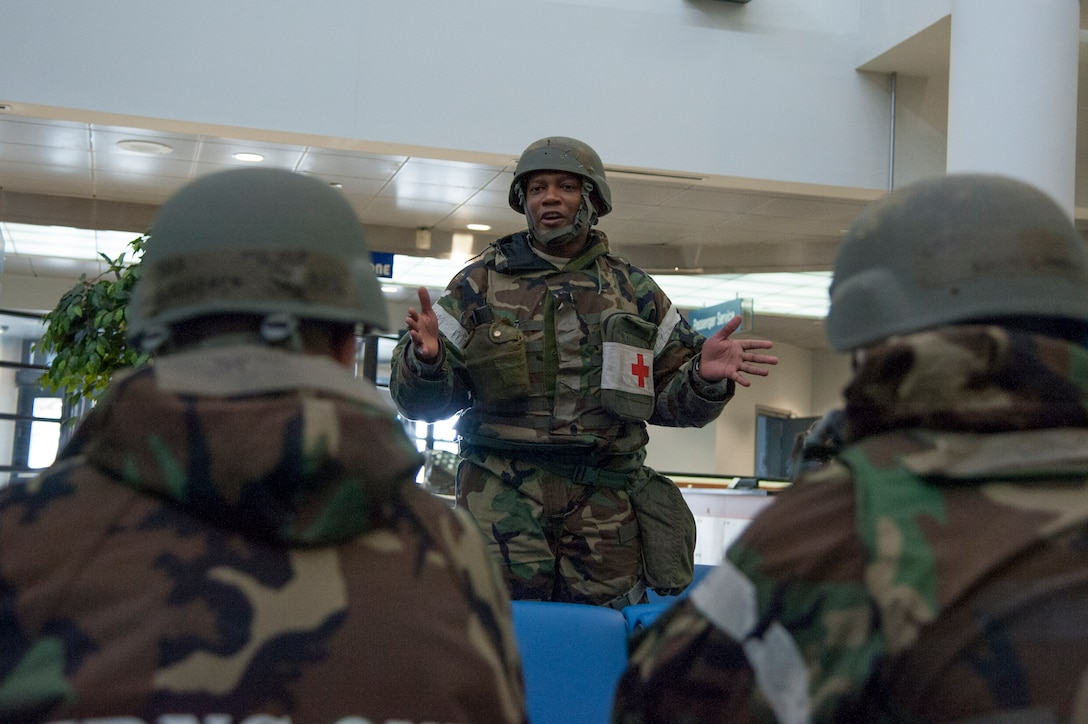 Staff Sgt. Kenous Carrington, a 51st Medical Operations Squadron mental health technician and member of the disaster mental health response team, simulates a briefing during operational readiness exercise Beverly Bulldog 15-1 Dec. 7, 2014, at Osan Air Base, Republic of Korea. In wartime environments, the mental health clinic would establish teams to offer military members preparatory education, intervention coordination, psychological screenings, and consultation on issues concerning operational combat stress. (U.S. Air Force photo by Senior Airman Matthew Lancaster)