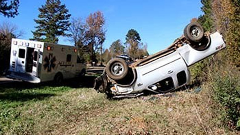 Marines with Bravo Company, 1st Battalion, 23rd Marine Regiment, 4th Marine Division, were the first on the scene of this overturned truck Nov. 26, 2014, after conducting a funeral detail. The woman inside, Patti Cranford, of Garrison, Texas, was on her way to the funeral when she lost control of her vehicle a mile away from the cemetery.