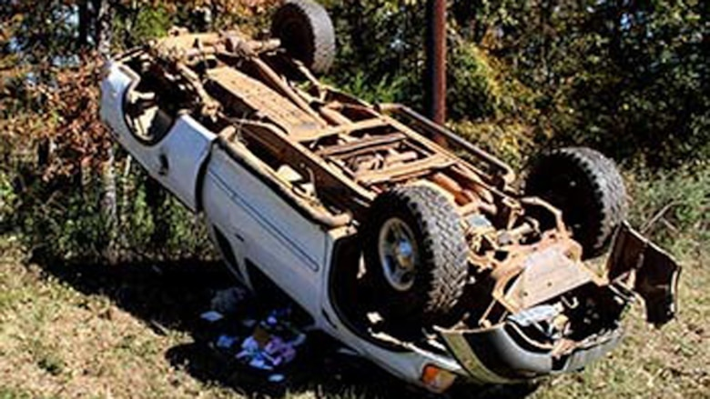 Marines with Bravo Company, 1st Battalion, 23rd Marine Regiment, 4th Marine Division, were the first on the scene of this overturned truck Nov. 26, 2014, after conducting a funeral detail. The woman inside, Patti Cranford, of Garrison, Texas, was on her way to the funeral when she lost control of her vehicle a mile away from the cemetery. (Photo by Scott Flowers)