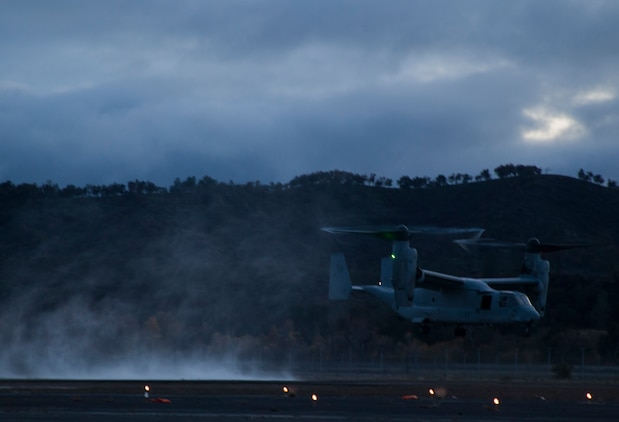 An MV-22B Osprey with Marine Medium Tilt-Rotor Squadron 161 (Reinforced) lands during Realistic Urban Training aboard Fort Hunter Liggett, Calif., Dec. 4, 2014. RUT prepares the 15th MEU Marines for their upcoming deployment, enhancing their combat skills in environments similar to those they may find in future missions. (U.S. Marine Corps photo by Cpl. Elize McKelvey/Released)
