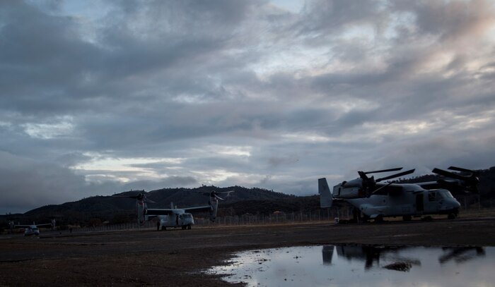 MV-22B Ospreys with Marine Medium Tilt-Rotor Squadron 161 (Reinforced) land during Realistic Urban Training aboard Fort Hunter Liggett, Calif., Dec. 4, 2014. RUT prepares the 15th MEU Marines for their upcoming deployment, enhancing their combat skills in environments similar to those they may find in future missions. (U.S. Marine Corps photo by Cpl. Elize McKelvey/Released)