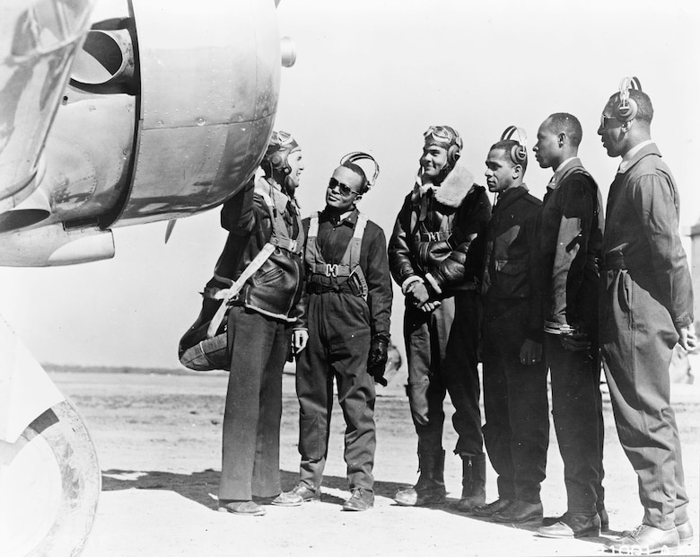 The first five fighter pilots graduated from Tuskegee on March 7, 1942. From left to right are R.M. Long (instructor); George Roberts; Benjamin O. Davis Jr.; Charles DeBow; Mac Ross; and Lemuel Curtis. (U.S. Air Force photo)