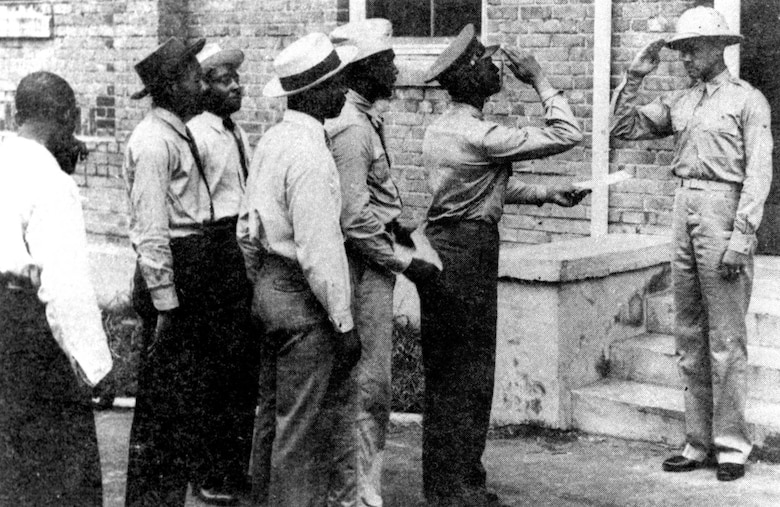 Capt. Benjamin O. Davis Jr. (right) greets some of the first aviation cadets at Tuskegee. (U.S. Air Force photo)
