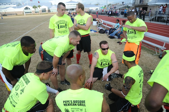 The Joint Branch team discusses game strategies during half time against the Mississippi Gulf Coast team