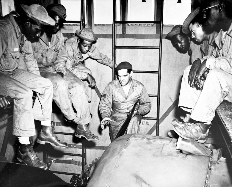 Enlisted Tuskegee Airmen receive instruction in aircraft engine maintenance at Selfridge Field, Mich. In combat, pilots depended upon the skill and training of these ground crew. (U.S. Air Force photo)
