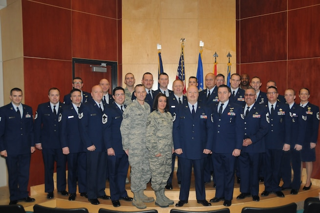 Fifty-two Community College of the Air Force degrees were awarded to 47 members of the Utah Air National Guard during a ceremony held at the Roland R. Wright Air National Guard Base in Salt Lake City, Utah on Dec. 6, 2014. (Air National Guard photo by Staff Sgt. Annie Edwards/RELEASED)