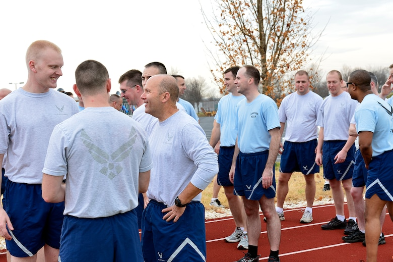MCGHEE TYSON AIR NATIONAL GUARD BASE, Tenn. - Chaplain Lt. Col. Bruce Brewer, third from left, talks with U.S. Air Force NCO Academy students here Dec. 5, 2014, during a fitness session on the I.G. Brown Training and Education Center's running track. Brewer is assigned as the lead chaplain for the 151st Air Refueling Wing, Utah Air National Guard. He served as TEC's interim Chaplain from July to December.  (U.S. Air National Guard photo by Master Sgt. Mike R. Smith/Released)