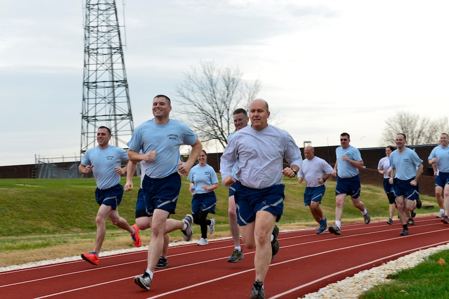MCGHEE TYSON AIR NATIONAL GUARD BASE, Tenn. - Chaplain Lt. Col. Bruce Brewer, front, joins U.S. Air Force NCO Academy students here Dec. 5, 2014, during a fitness session on the I.G. Brown Training and Education Center's running track. Brewer is assigned as lead chaplain for the 151st Air Refueling Wing, Utah Air National Guard. He served as TEC's interim Chaplain from July to December.  (U.S. Air National Guard photo by Master Sgt. Mike R. Smith/Released)